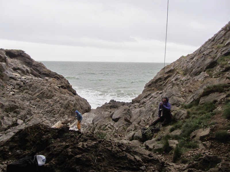Anna belaying and the sea roaring